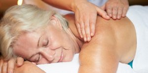 older woman receiving massage for fibromyalgia